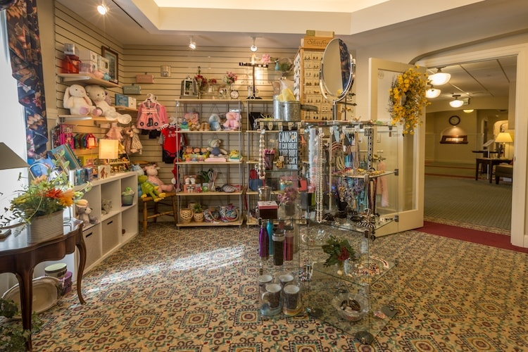 there are plush animals, jewelry, clothes, and other items on display