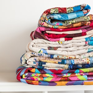 Folded quilts stacked