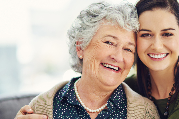 Caregiver daughter and her mother enjoying the benefits of respite care services