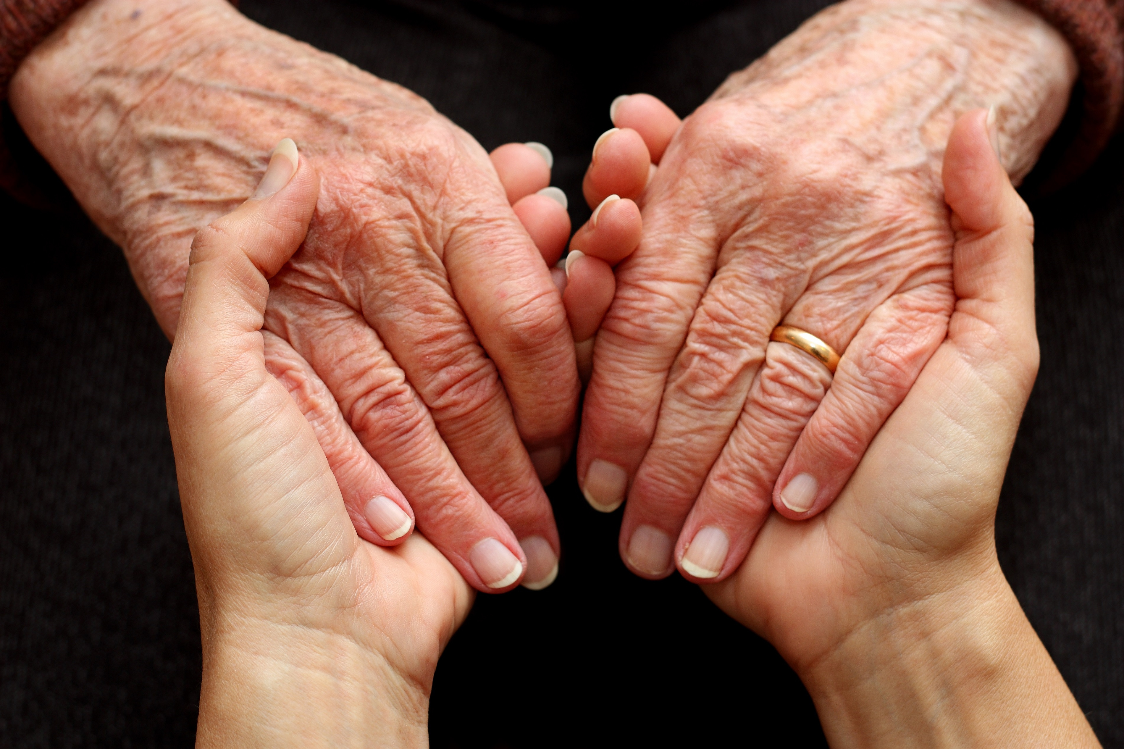 Holding hands is an essential form of sensory therapy for dementia