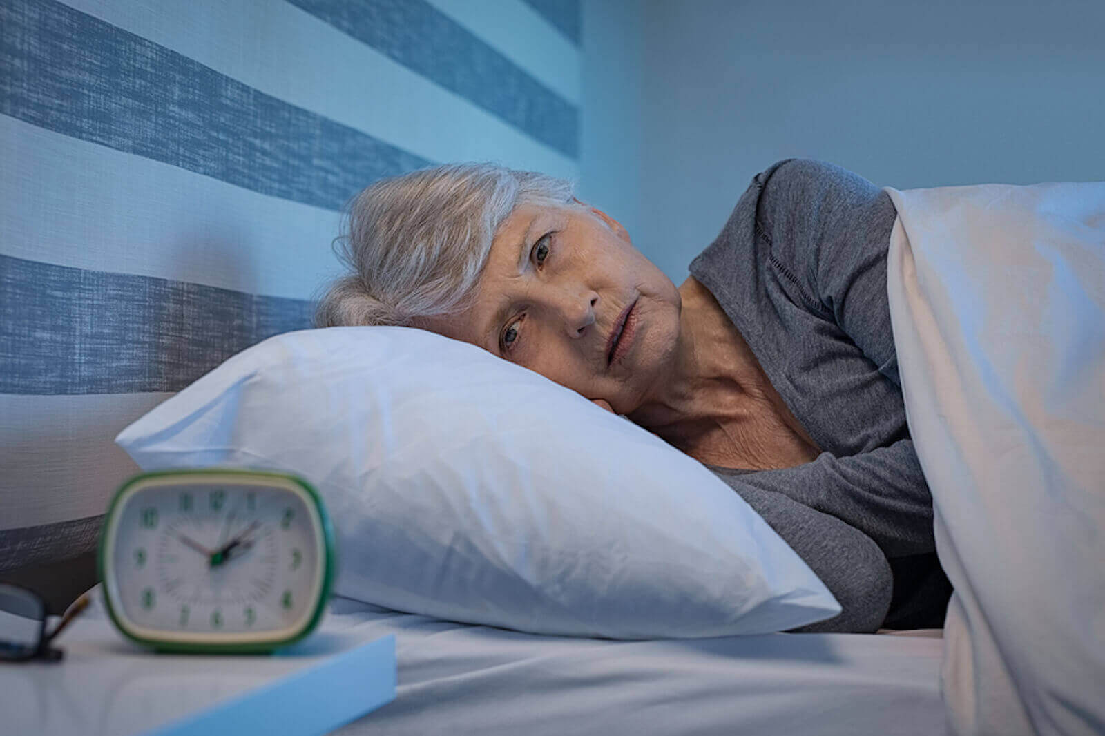 Senior woman worries about getting enough sleep