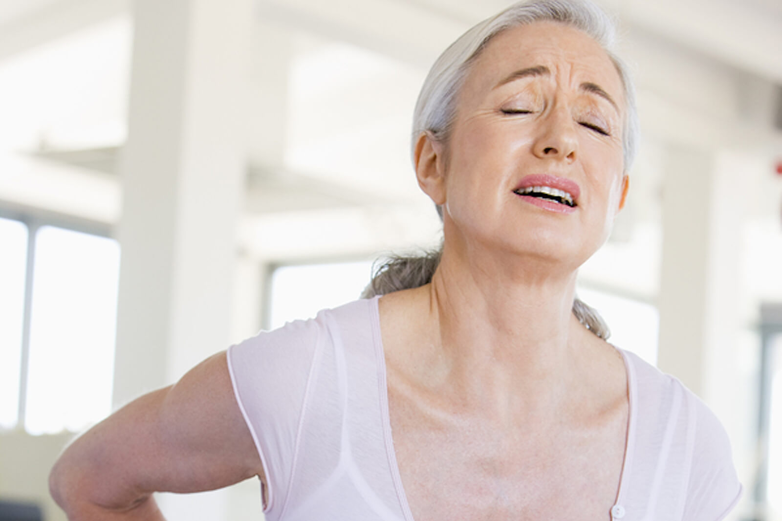 A woman suffers from back pain