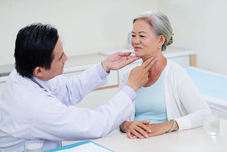 doctor examining senior