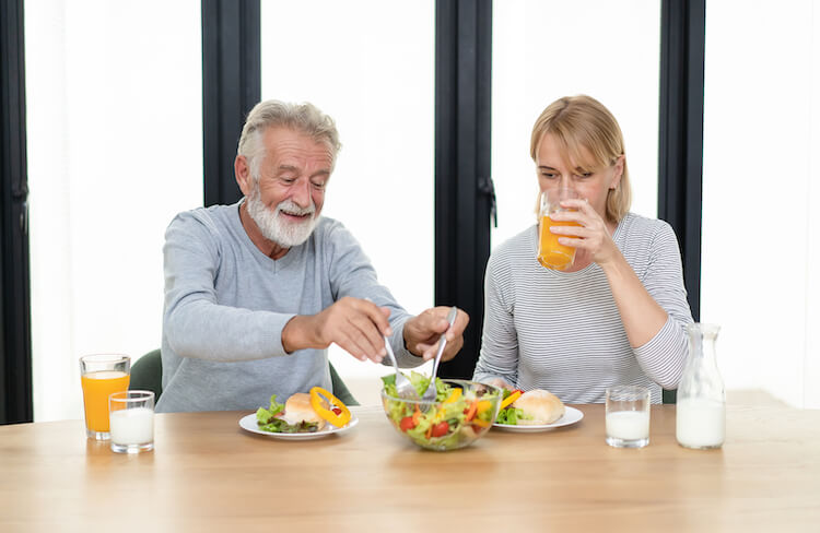 Senior couple eating a healthy meal