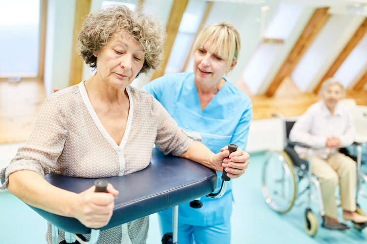 A senior woman participates in physical rehab after suffering a stroke.