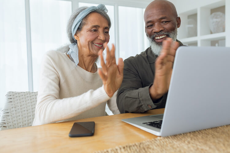 Senior couple using video chat to connect with family members.