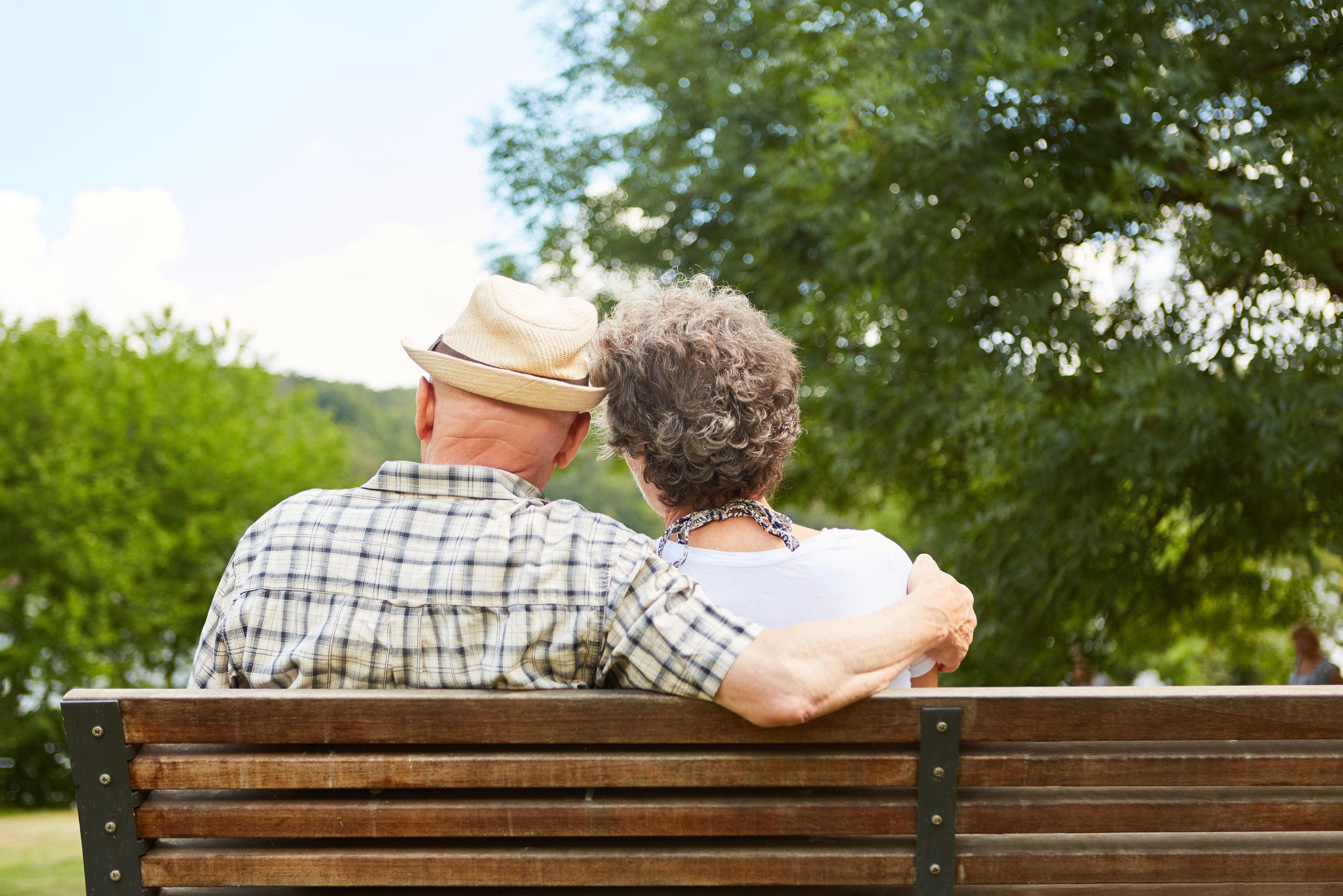 ALT. TEXT Happy senior couple enjoying a summer day outside.
