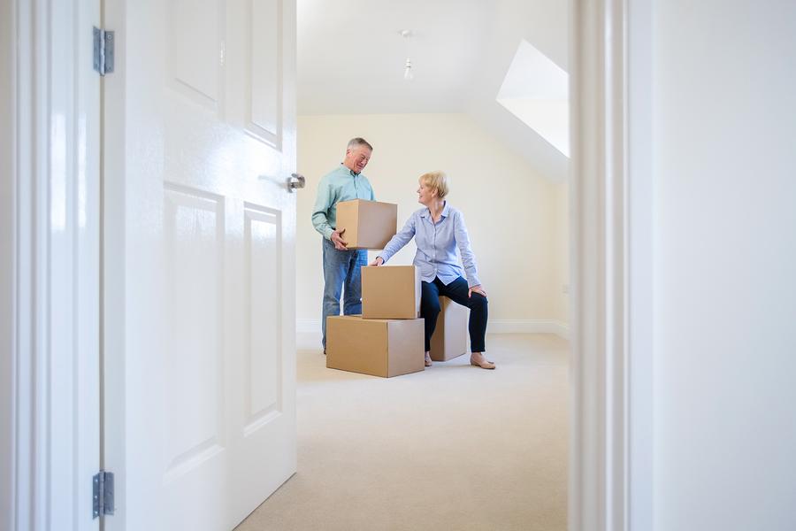 Senior couple downsizing into a senior living community.