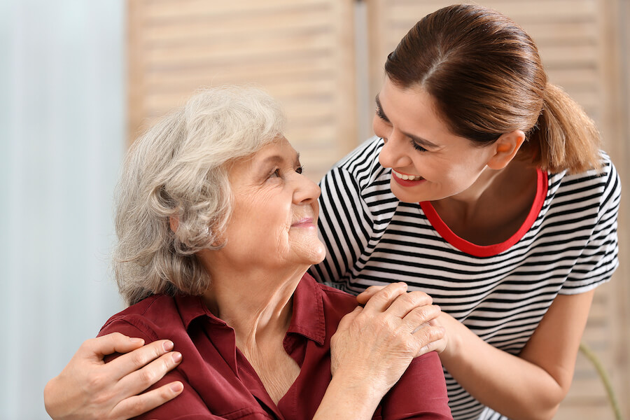 Young caregiver spending time with a loved one living with dementia.